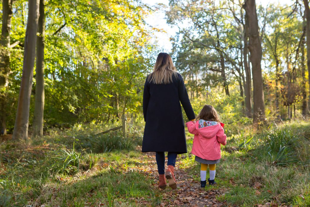 mum and daughter holding hands in woods-3