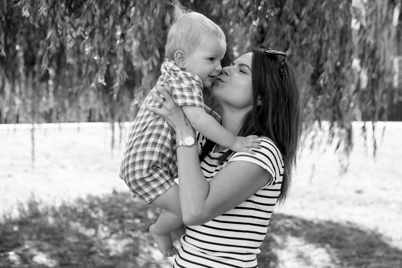 bucks newborn photography mum kissing baby b&W_