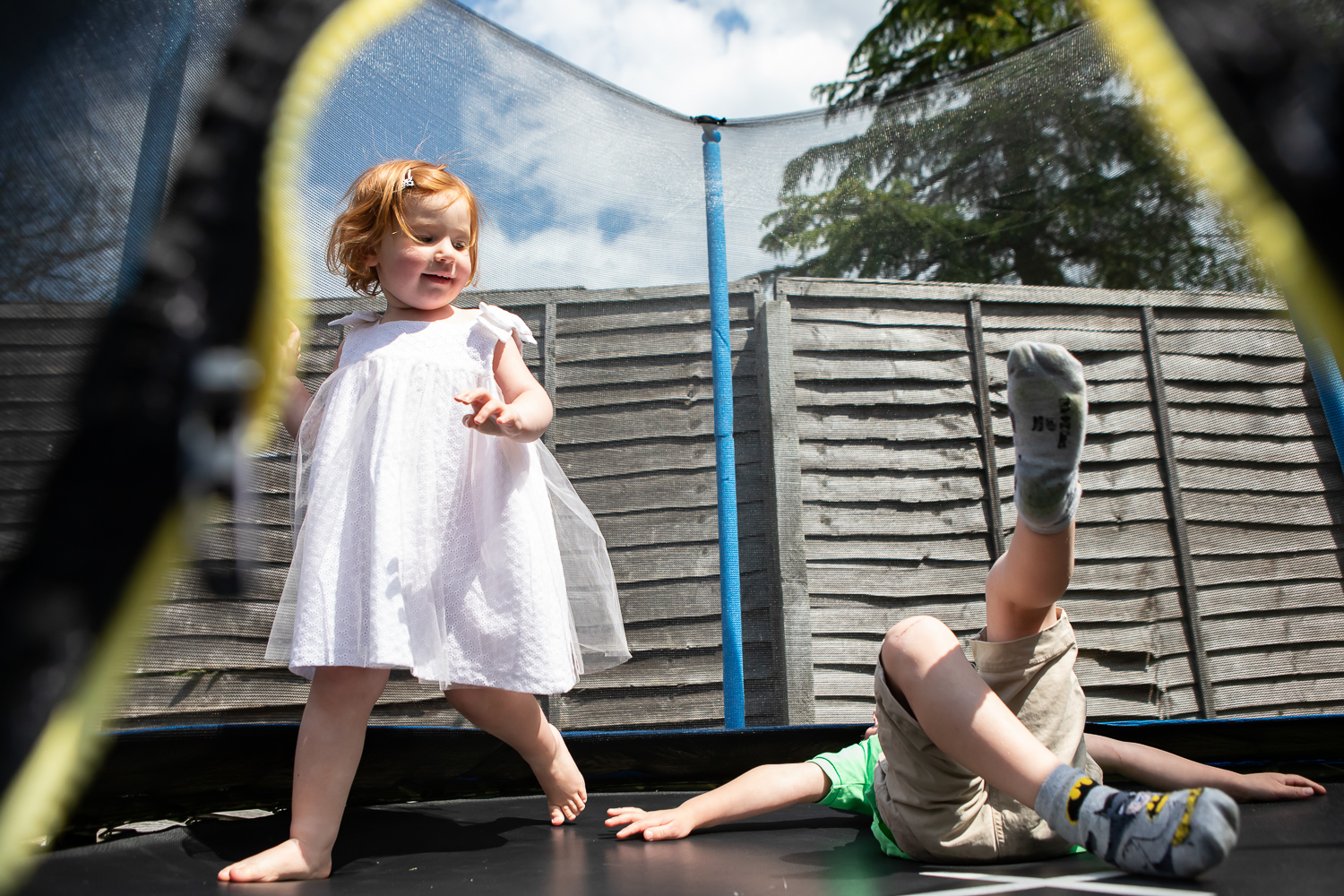 girl and boy playing on trampoline Bucks family photography_