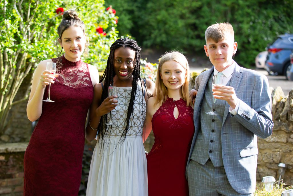 natural prom photography, four friends smiling _