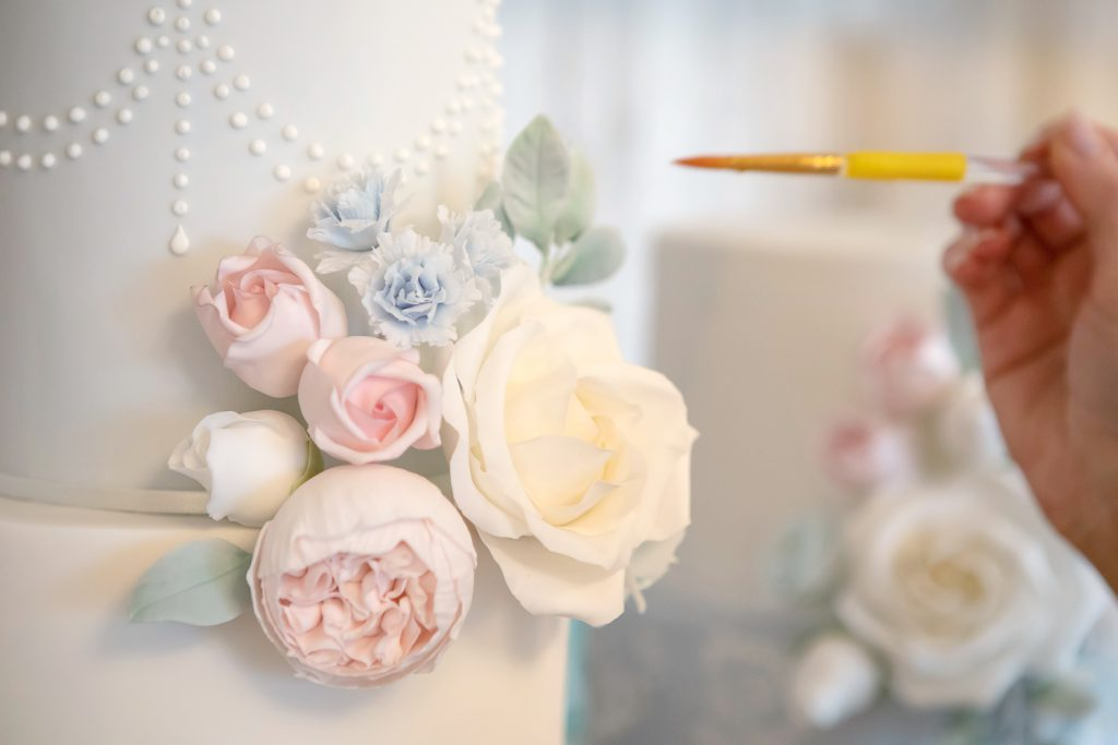 painting sugar roses, wedding cake