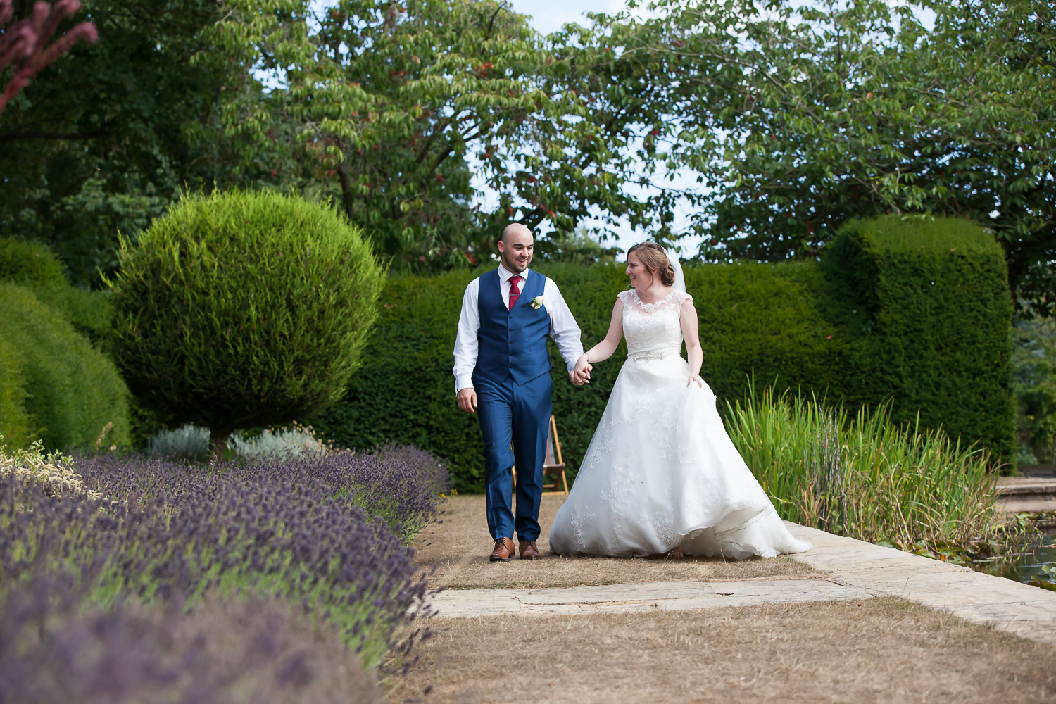 bride and groom by lavender Horwood House